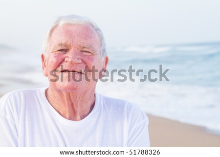 closeup of male senior citizen on beach - stock photo