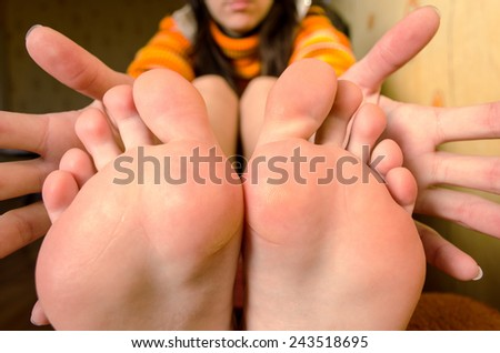 Closeup of male therapist giving foot massage to female customer at beauty spa
