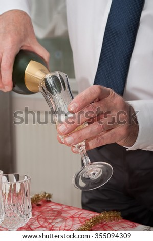 closeup of man pouring champagne into a glass