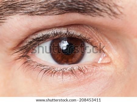Closeup of man's eye  - stock photo