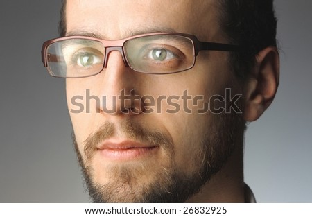 closeup of man's face with glasses - stock photo