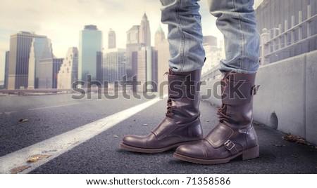 Closeup of man's fashion shoes on a city street - stock photo