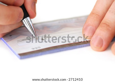 Closeup of man's hands writing a cheque - stock photo