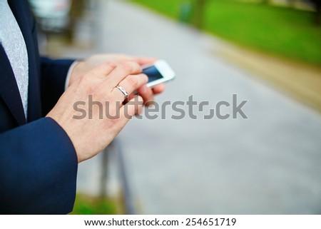 Closeup of man using mobile smart phone - stock photo