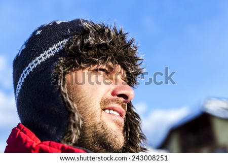 Closeup of man wearing a winter hat  outside - stock photo
