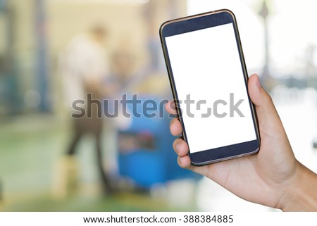 closeup of man with broken car and smart phone, Man hand holding mobile smart phone , tablet,cellphone over Blurred of car technician repairing the car in garage background,vintage color. - stock photo