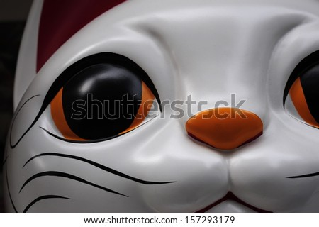 Closeup of maneki neko - stock photo