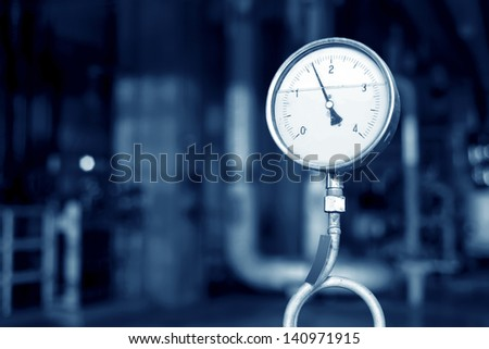 Closeup of manometer, pipes and faucet valves of heating system in a boiler room