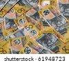 Closeup of many Australian 50 dollar notes. - stock photo