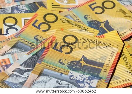Closeup of many Australian 50 dollar notes. Shallow depth of field - stock photo