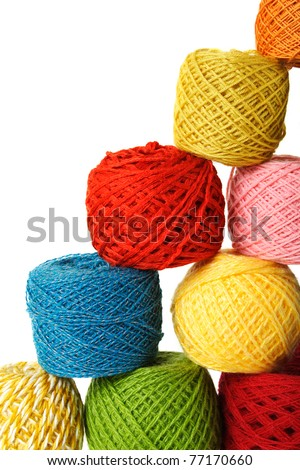closeup of many multicolored clews in pyramid, isolated - stock photo