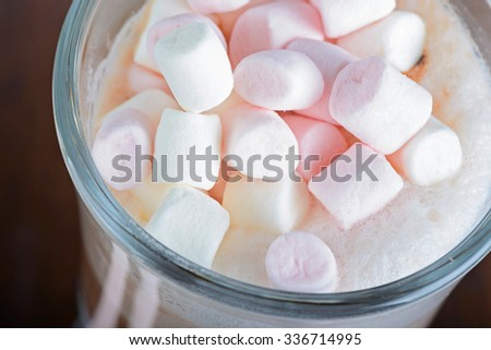 Closeup of marshmallows in hot chocolate in the glass - stock photo