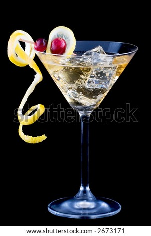 Closeup of martini glasse with lemon and cranberry splash cocktail over black background - stock photo