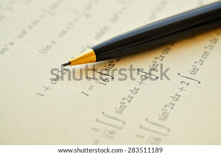 Closeup of mathematical lessons on differential and integral calculus - stock photo