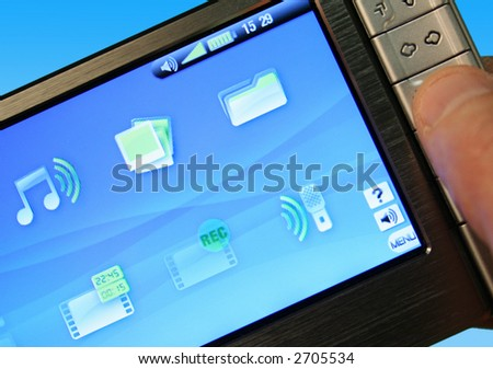 Closeup of media player against graduated bule background - stock photo