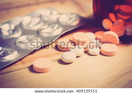 Closeup of medical capsule or pill or drug. A lot of colorful medication and pills. - Vintage tone.