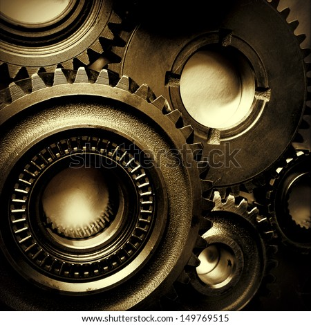 Closeup of metal cog gears - stock photo