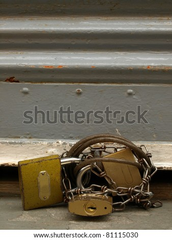 closeup of metal door whit locks - stock photo