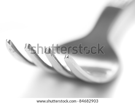 closeup of metal fork on a white background - stock photo
