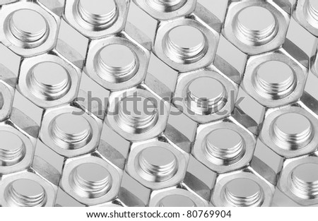 closeup of metal nuts background - stock photo