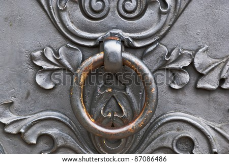 Closeup of metal vintage door with metal door handle, old vintage style taken in Moscow, Russia