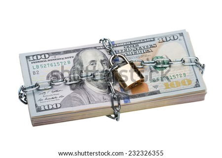 Closeup of metallic chain and padlock around dollar bundle isolated over white background