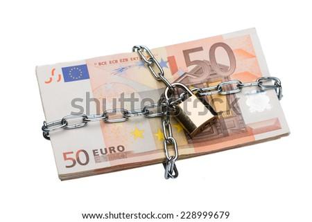 Closeup of metallic chain and padlock around euro bundle isolated over white background - stock photo