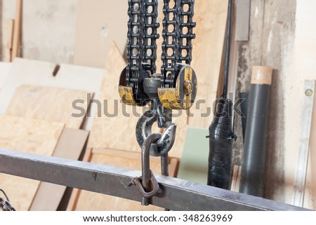 Closeup of Metallic industrial hook for lifting heavy thing in the factory - stock photo