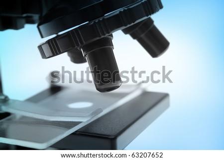 Closeup of microscope - stock photo
