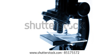 Closeup of microscope, copy space - stock photo