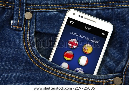 closeup of mobile phone with language learning application in jeans pocket. focus on screen - stock photo