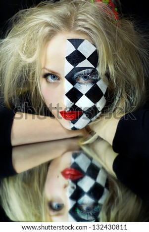 Closeup of model with a chess pattern on mirror - stock photo