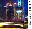 closeup of modern building and garden bridge in shanghai at night - stock photo
