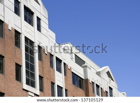 closeup of modern building exterior with blue sky