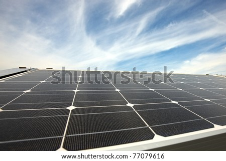 closeup of modern solar panels on a roof - stock photo