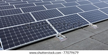 closeup of modern solar panels on roof - stock photo