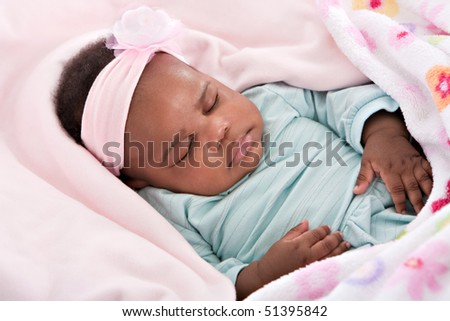 Closeup of 3 Month Old Little Baby African American Girl Sleeping in Cradle - stock photo