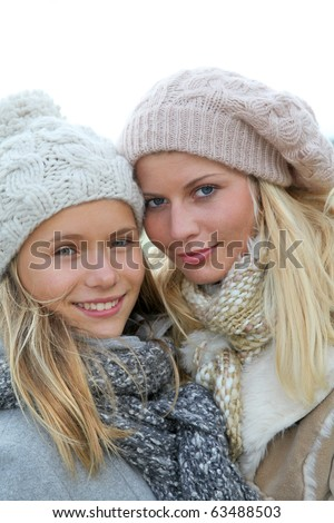 Closeup of mother and daughter in fall - stock photo