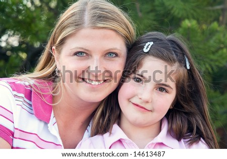 Closeup of Mother and Daughter Smiling - stock photo