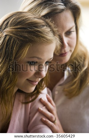 Closeup of mother with teenage daughter - stock photo