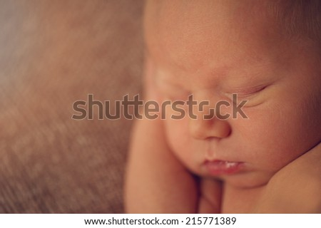 Closeup of Mouth - Sleeping Naked Newborn - stock photo