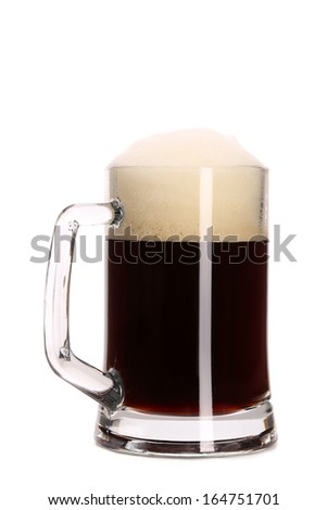 Closeup of mug full with brown beer. Isolated on a white background.