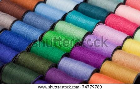 Closeup of multicolored threads - stock photo