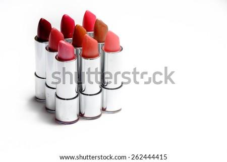 Closeup of multiple lipsticks isolated on white background - stock photo