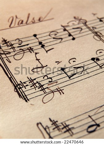closeup of music sheets on an old paper - stock photo