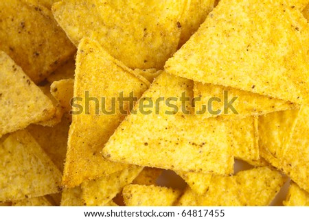 closeup of nachos with guacamole on a white background - stock photo