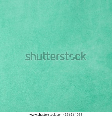 Closeup of natural background - green suede. - stock photo