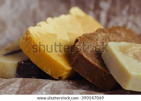 Closeup of natural handmade soap on brown rustic background. Shallow focus
