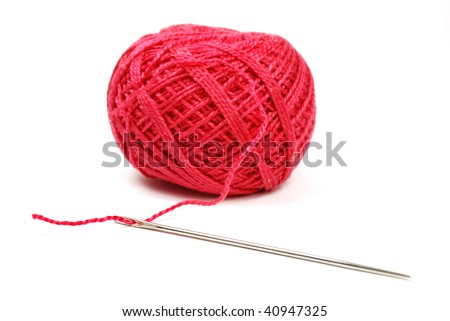 closeup of needle and red clew isolated