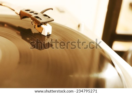 Closeup of needle on spinning vinyl record
